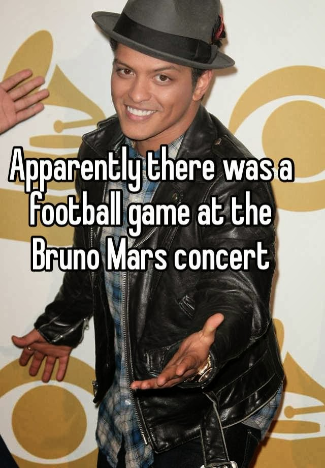 attractive Bruno Mars holding out his hand, Apparently there was a football game at the Bruno Mars concert; Superbowl 2014; #BrunoMars