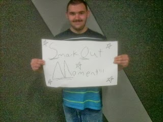 fan holding wrestling crowd sign Friday Night SmackDown