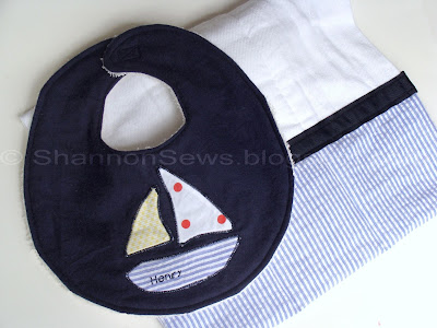Applique baby bib with matching seer sucker burp cloth