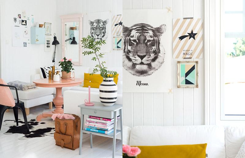 Uma sala com uma cartela bastante simples: branco e rosa