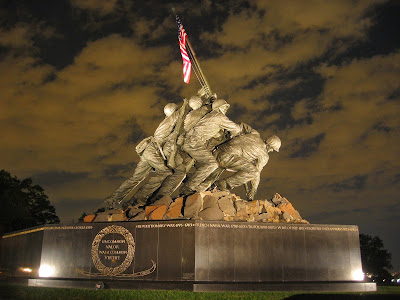 United States Marine Corps War Memorial by Felix de Weldon at night.