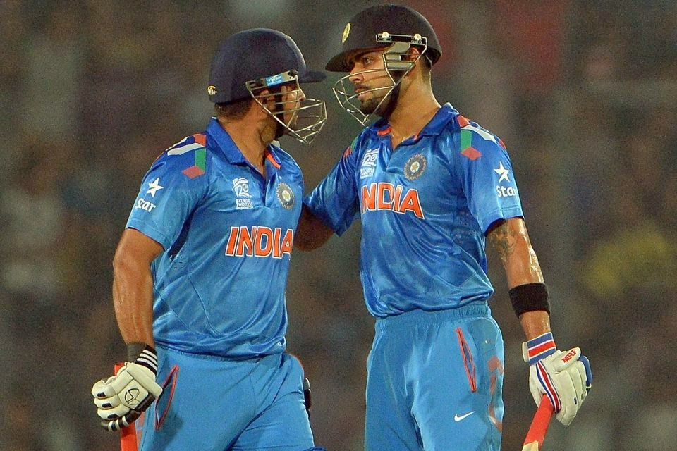 Virat-Kohli-Suresh-Raina-India-vs-England-WT20-Warm-up-2014