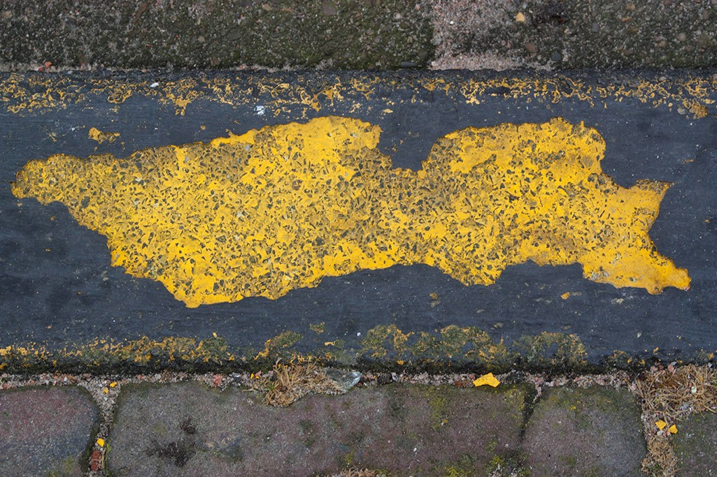 chipped yellow street curb