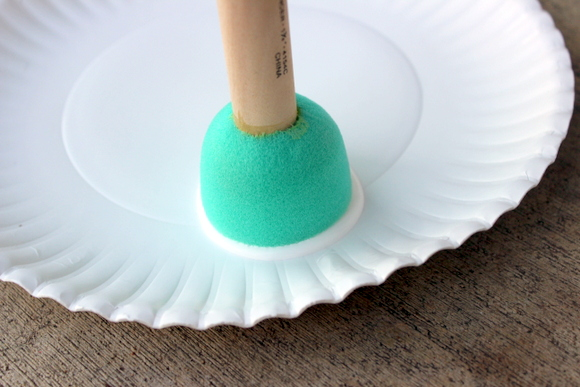 Put the paint on a paper plate and then get the paint on your circle sponge.
