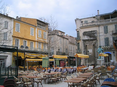 """Arles-PlaceDuForum"". Licensed under Public Domain via Wikimedia Commons - http://commons.wikimedia.org/wiki/File:Arles-PlaceDuForum.jpg#/media/File:Arles-PlaceDuForum.jpg"