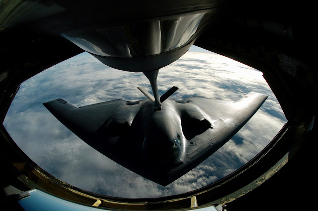 A B-2 Spirit bomber refuels from a KC-135 Stratotanker