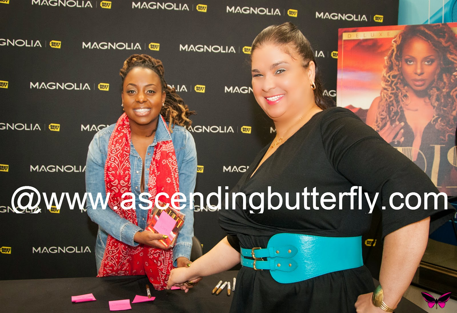 Ascending Butterfly shakes Ledisi hand at The Truth Album Signing at Best Buy
