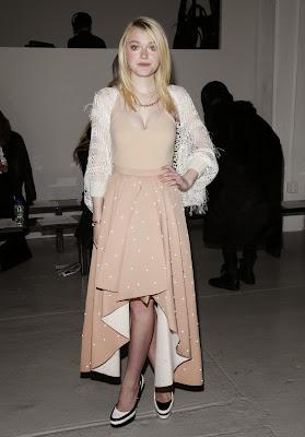 Dakota Fanning Shows Cleavage at Rodarte Fashion Show