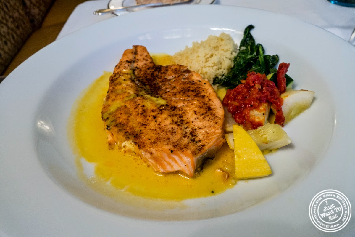image of salmon with lemon saffron sauce at Le Périgord in New York, NY