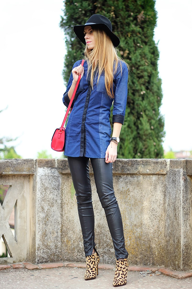 leather pants, denim shirt, red crossbody bag, fedora, leopard ankle boots