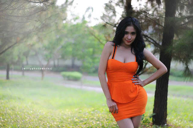 bibie_julius_model_in_orange_dress_1.jpg