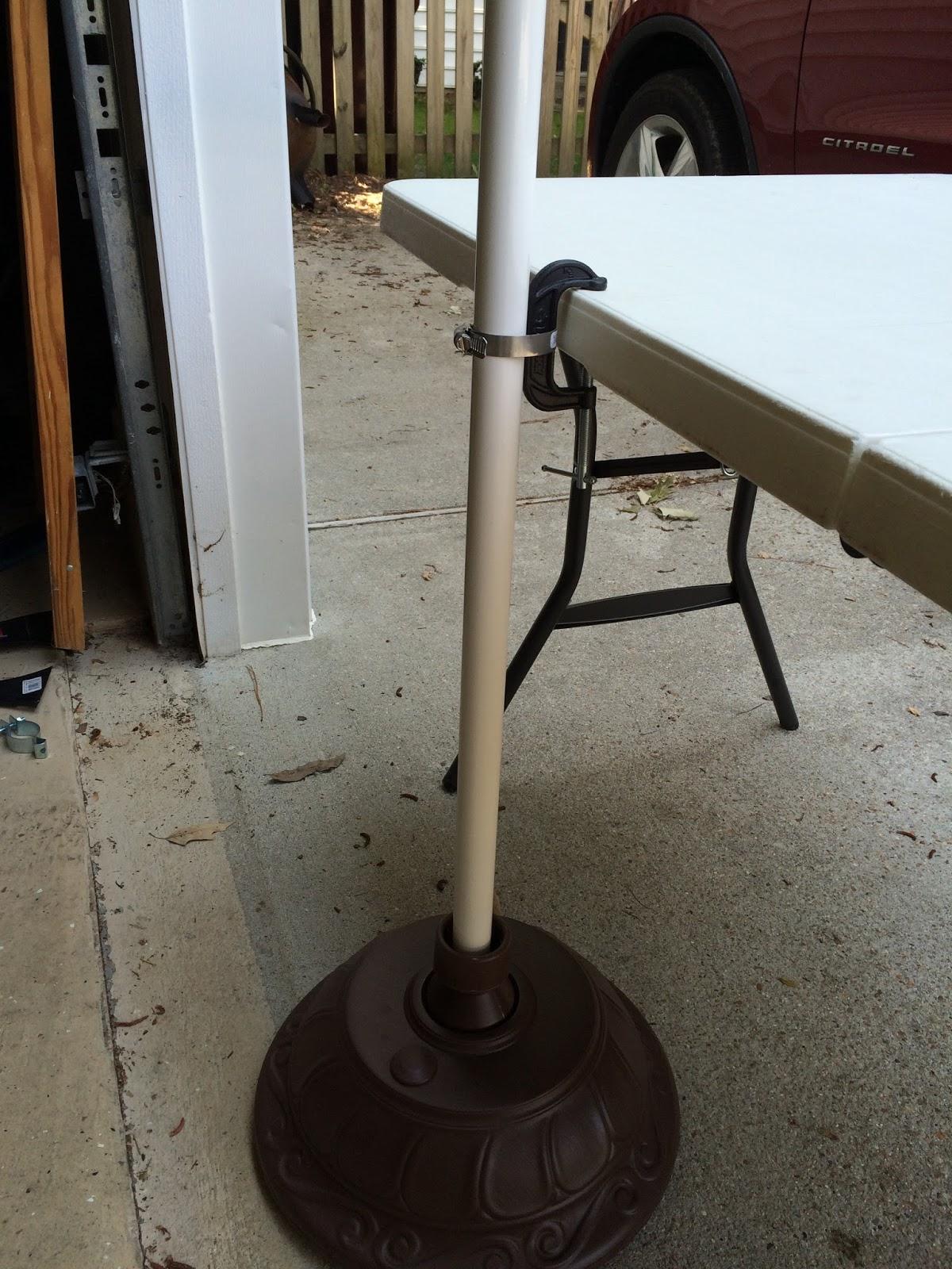 Securing A Market Umbrella At An Outdoor Craft Show