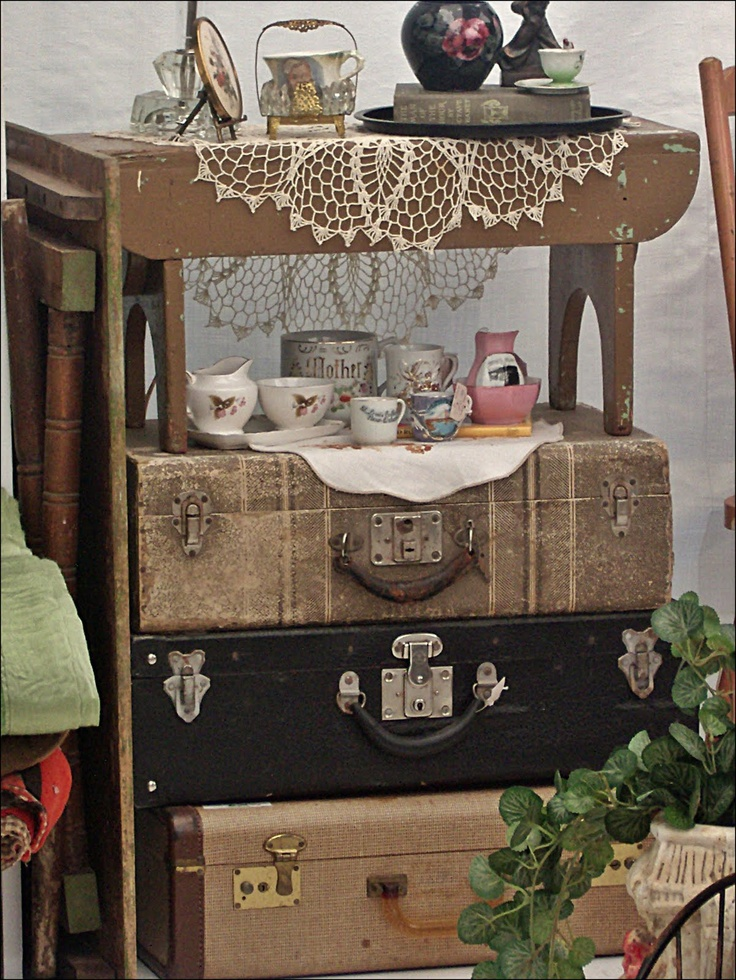 ethnic cottage decor decorating with vintage luggage