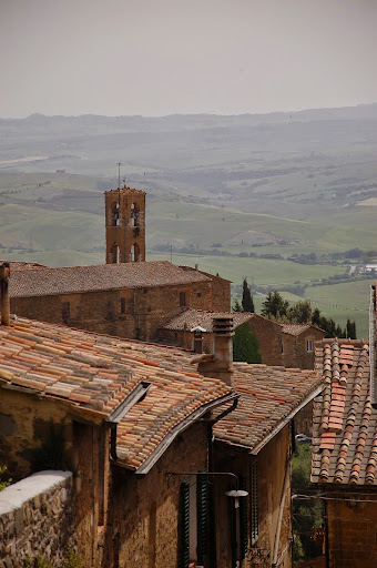The hills of Val d'Orcia via the rooftops of Montalcino