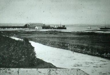 Stokes Bay Pier with HMS Iris