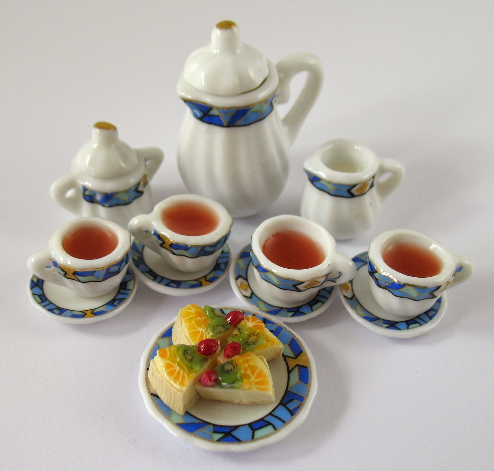 https://www.etsy.com/listing/83774855/dollhouse-miniature-food-tea-and?ref=shop_home_active_2