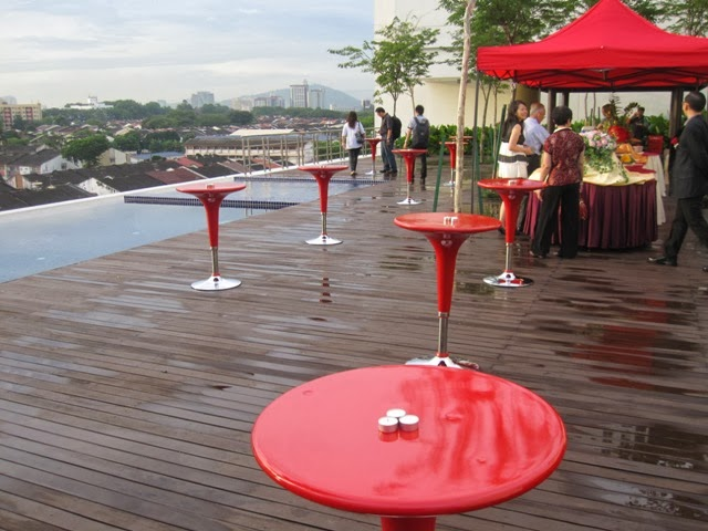 tall red tables, after rain