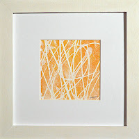 Yellow framed abstract painting