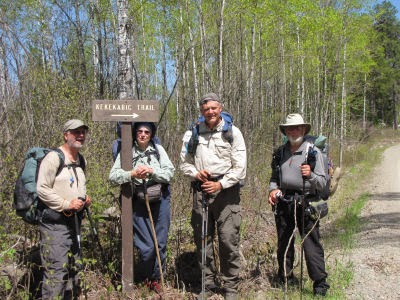 hikers by Kekekabic Trail sign
