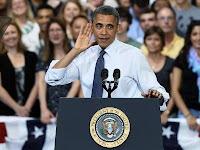 President Barack Obama listens
