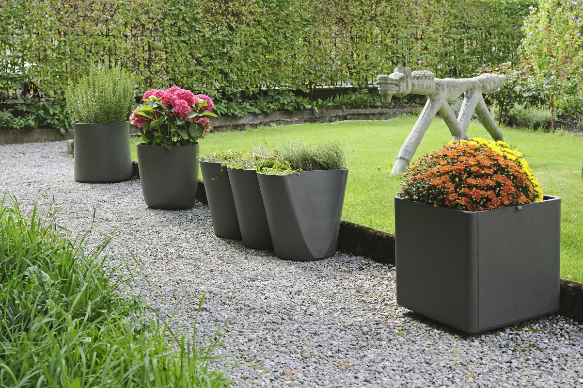 Design for the garden modern design by for Yard planter ideas