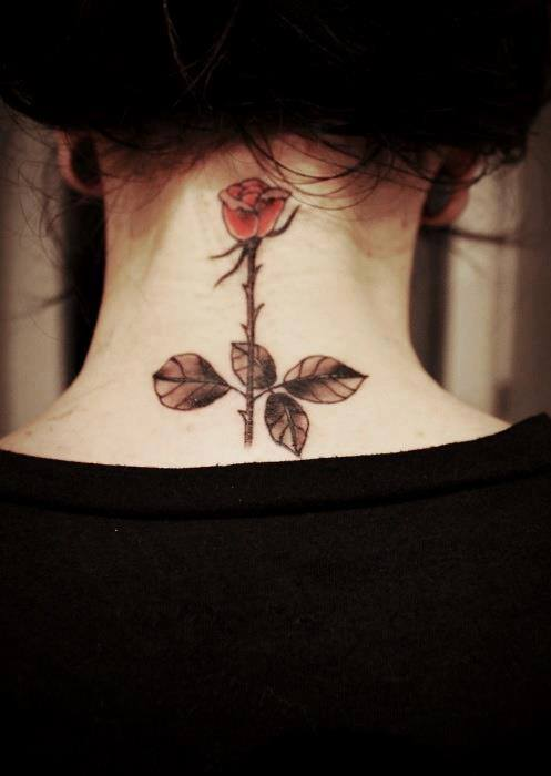 Red rose tattoo on back neck