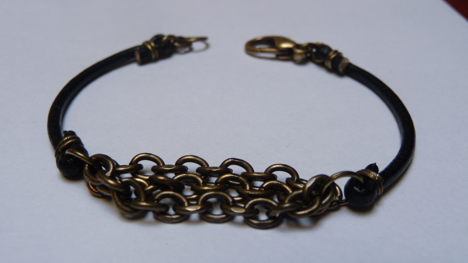 and stuff leather cord and metal chain bracelet