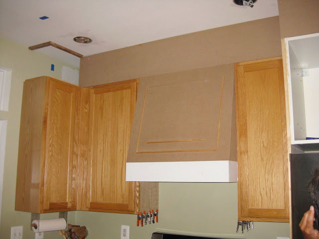 MDF and moldings are used to cover space above cabinets