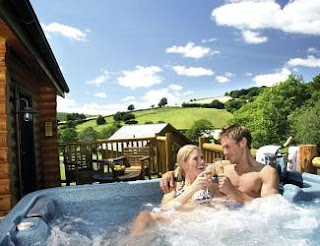 Relax in a Private Hot Tub with the Log Cabin