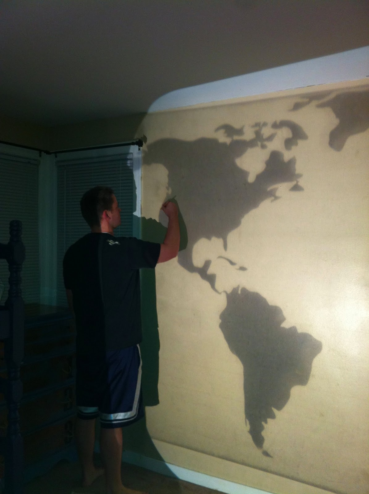 Diy world map wall mural classy clutter for Best projector for mural painting
