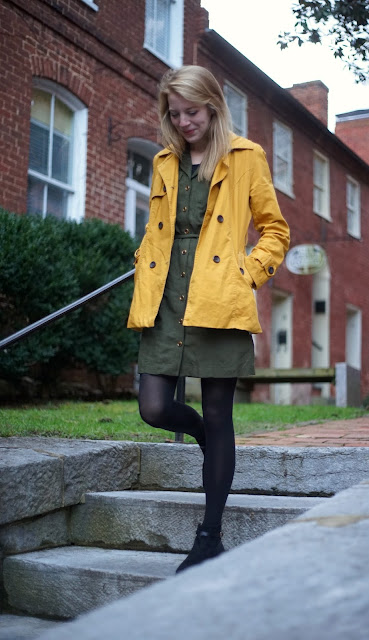 Girl with yellow coat walking down steps