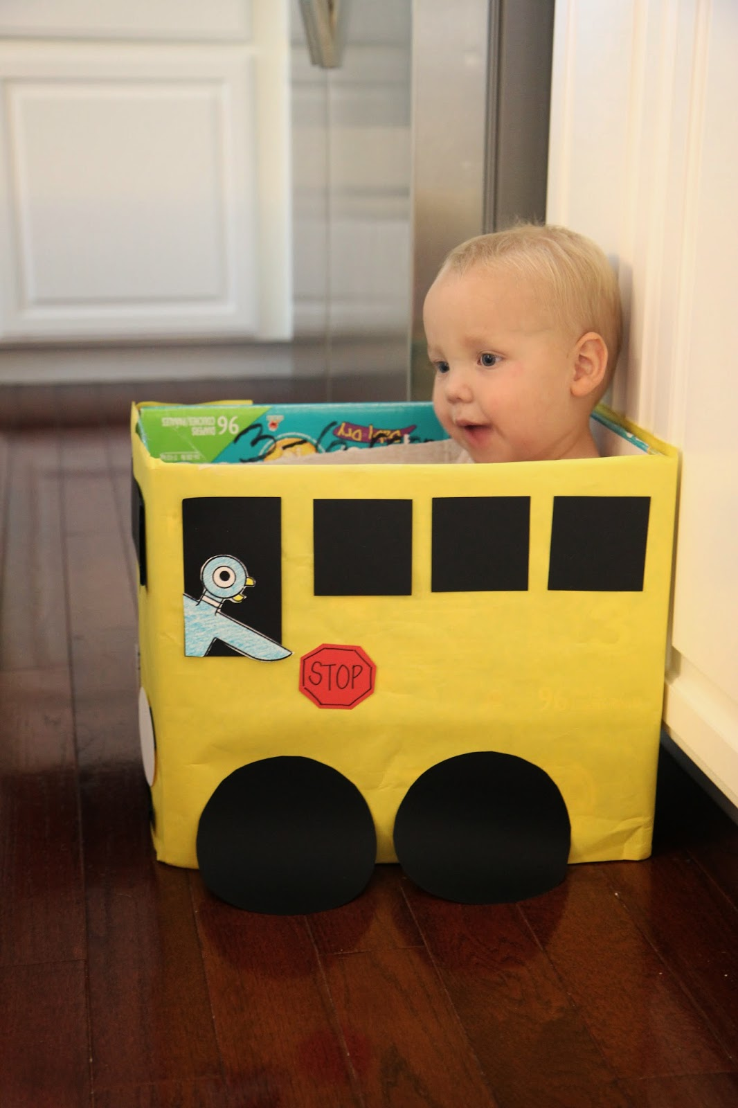 Toddler approved cardboard box bus craft number game for Craft box for toddlers