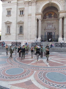 Filipino  tourist pilgrims singing in front of St Stephens Basilica in Budapest.