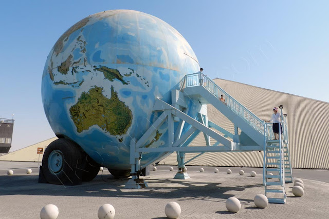 Giant globe shaped two wheel caravan