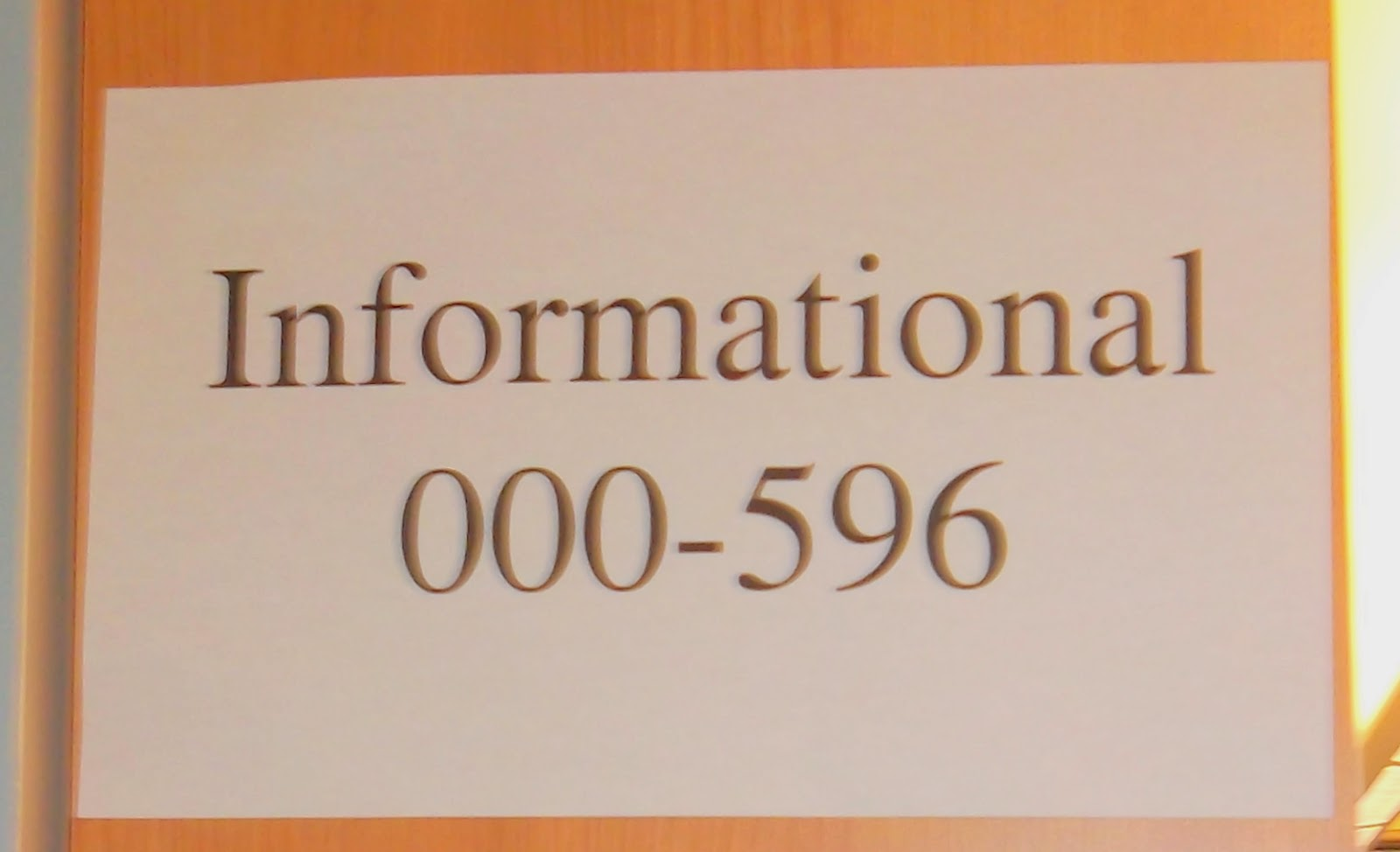 Sign bearing the word Informational and Dewey Decimal number range 000 to 596