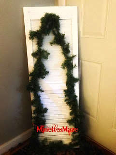 DIY Shutter Christmas Tree tutorial. So cute and easy! Take an old shutter, attach garland, lights, a bow, a cute sign and you're done! Easy step by step instructions!