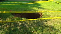 hole in the ground pit fall in scary cave in collapse haunted creepy