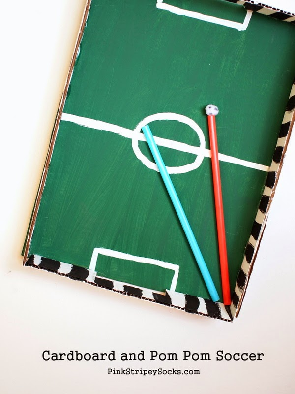 make a cardboard and pom pom soccer game