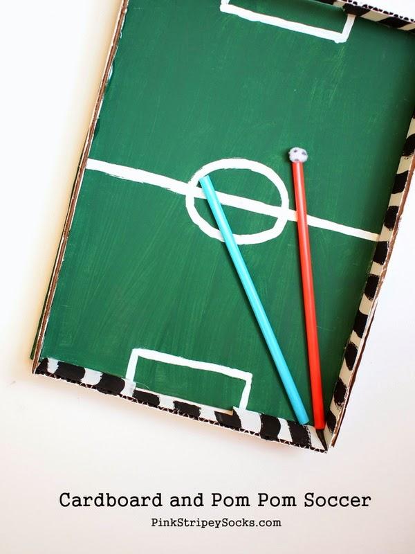 make a cardboard and pom pom soccer game