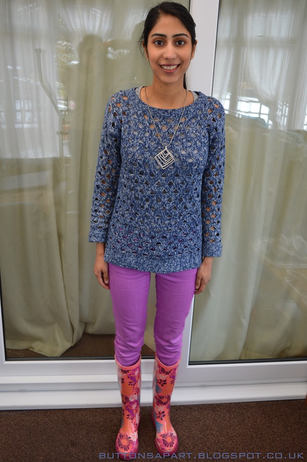 a picture of an outfit featuring a blue knitted jumper, lilac skinny jeans and wellington boots