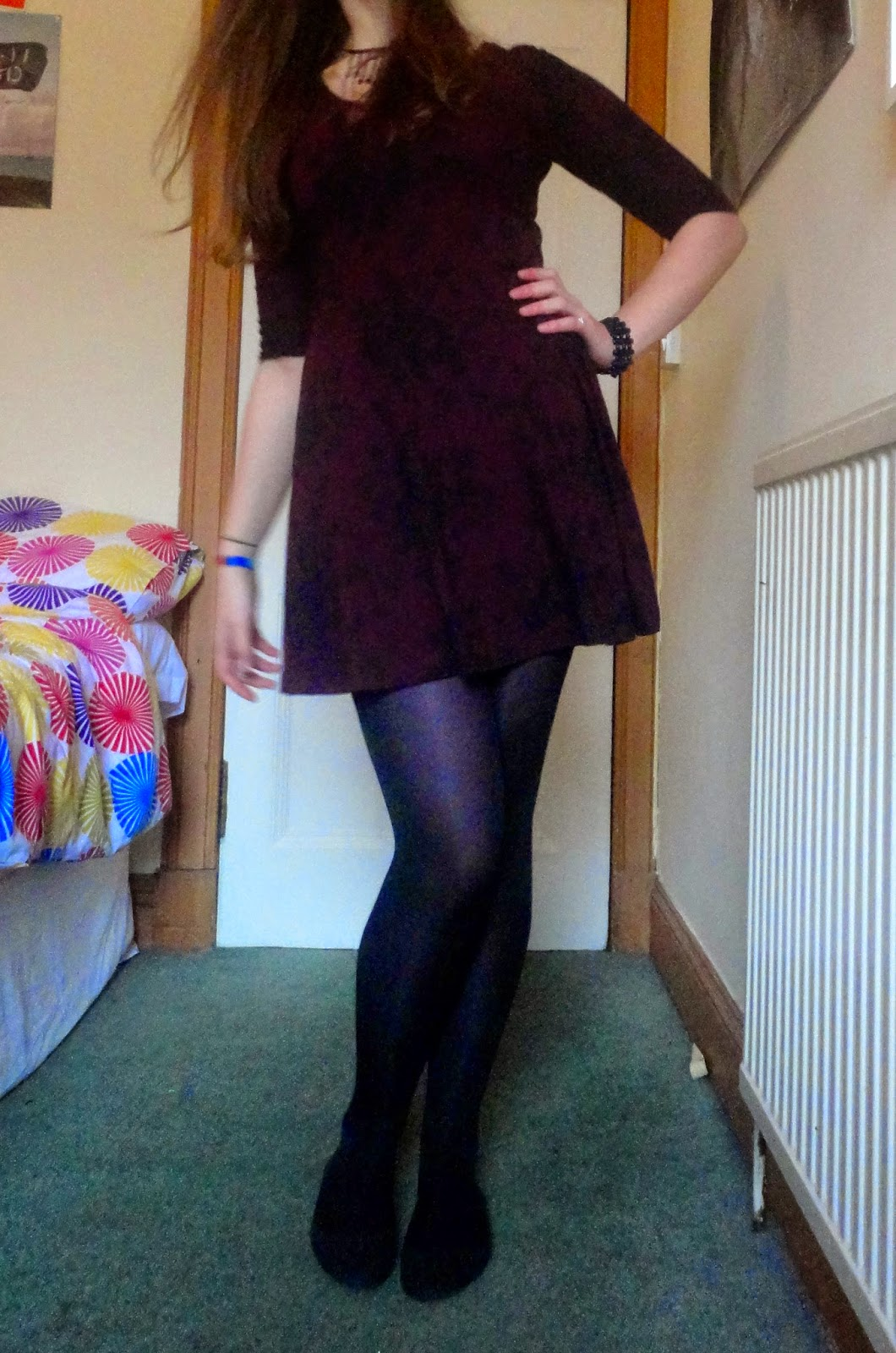 Wildflowers | outfit of short black and purple floral dress, with black flat shoes, tights and jewellery