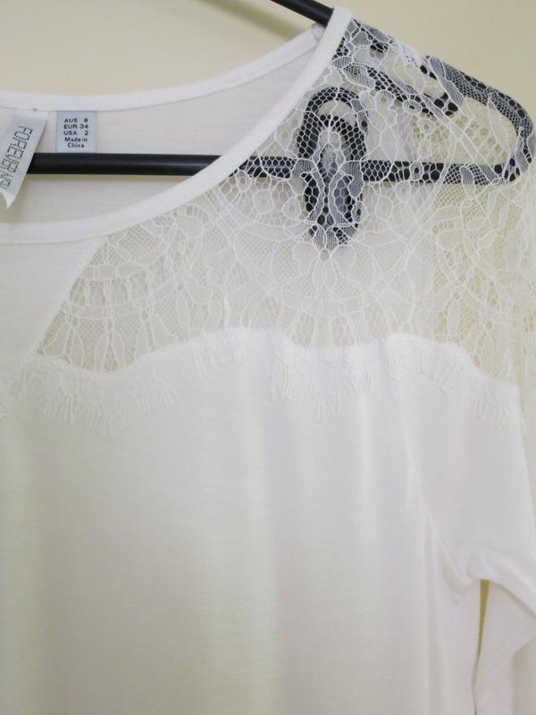 Cream top with cream lace insert on neckline