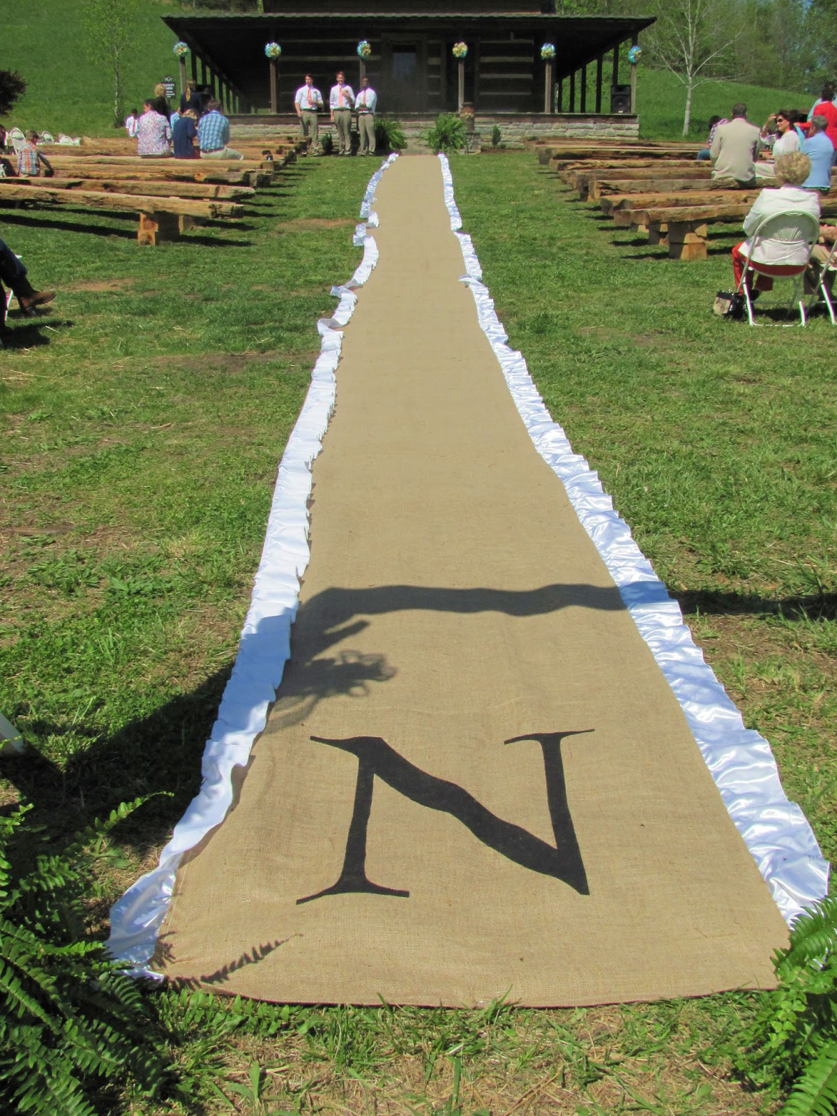 burlap and satin aisle runner i done for the wedding i love how it turned out it was very time consuming but the finished project was so worth it