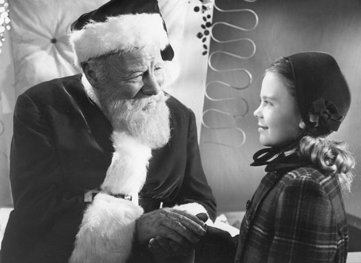 Kris holds Susan's hand in Miracle on 34th Street