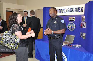SHSU student talks to a Beaumont Police Officer during the 2012 Career Fair.