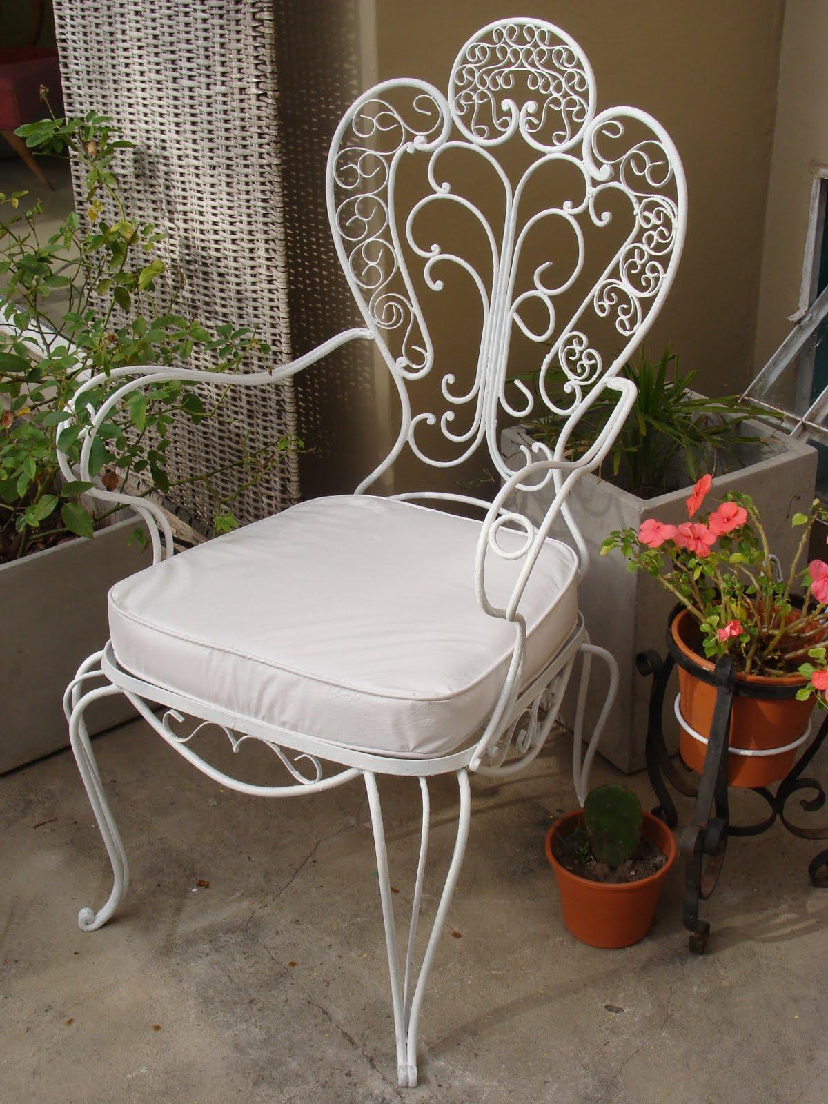 So glittering la silla de hierro forjado for Mecedoras para jardin