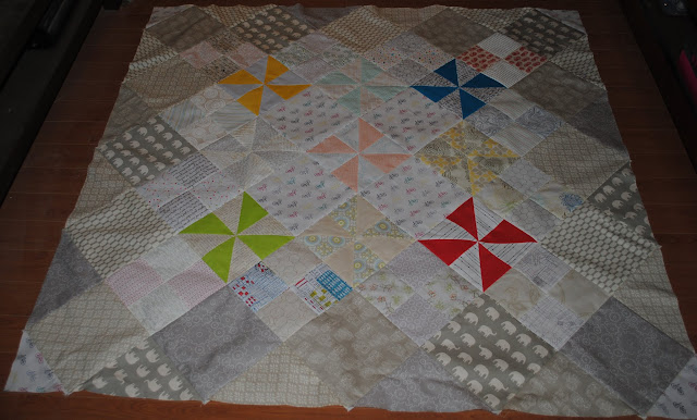 low volume pinwheel quilt top inside