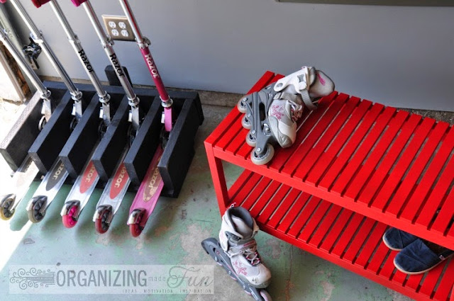 Scooter organizer and a red bench for sitting down to put on roller blades :: OrganizingMadeFun.com