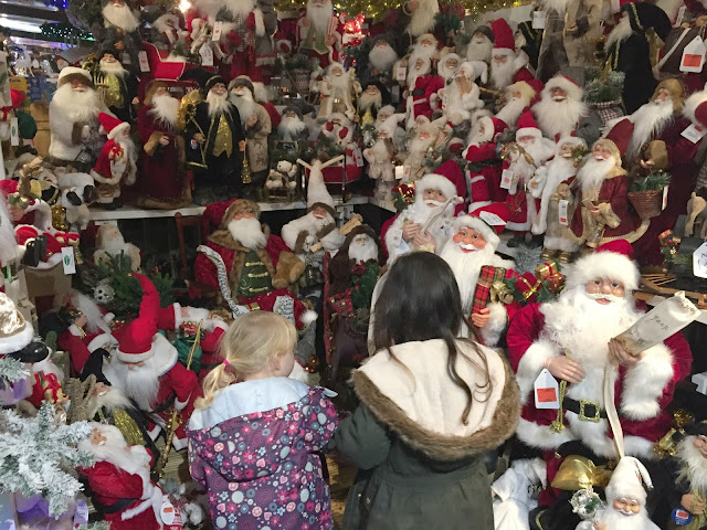 A display of hundreds of Santa dolls and statues