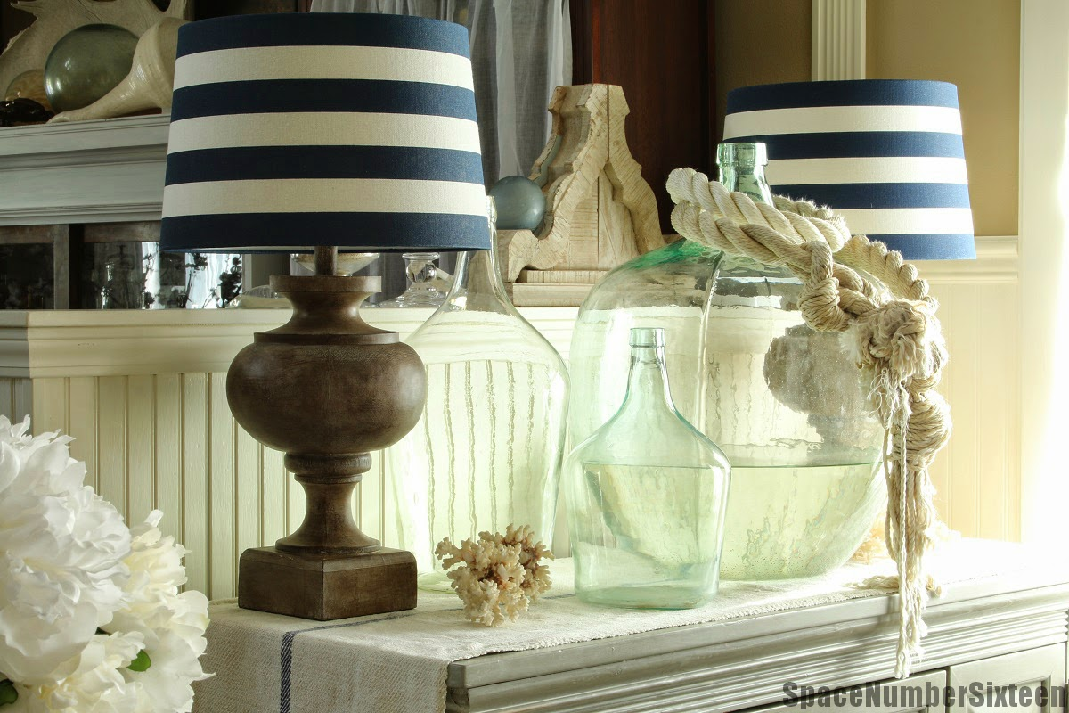 large rope, demijohns, striped lamp shades, coral